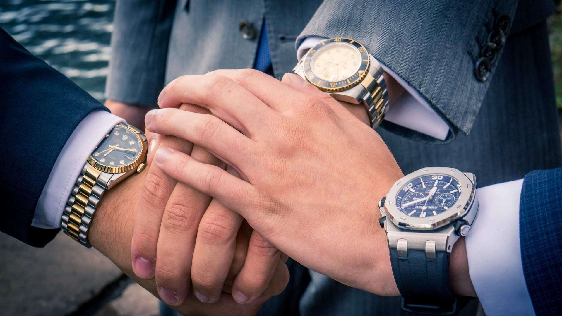 A Rolex on the wrist tells a tale of success.