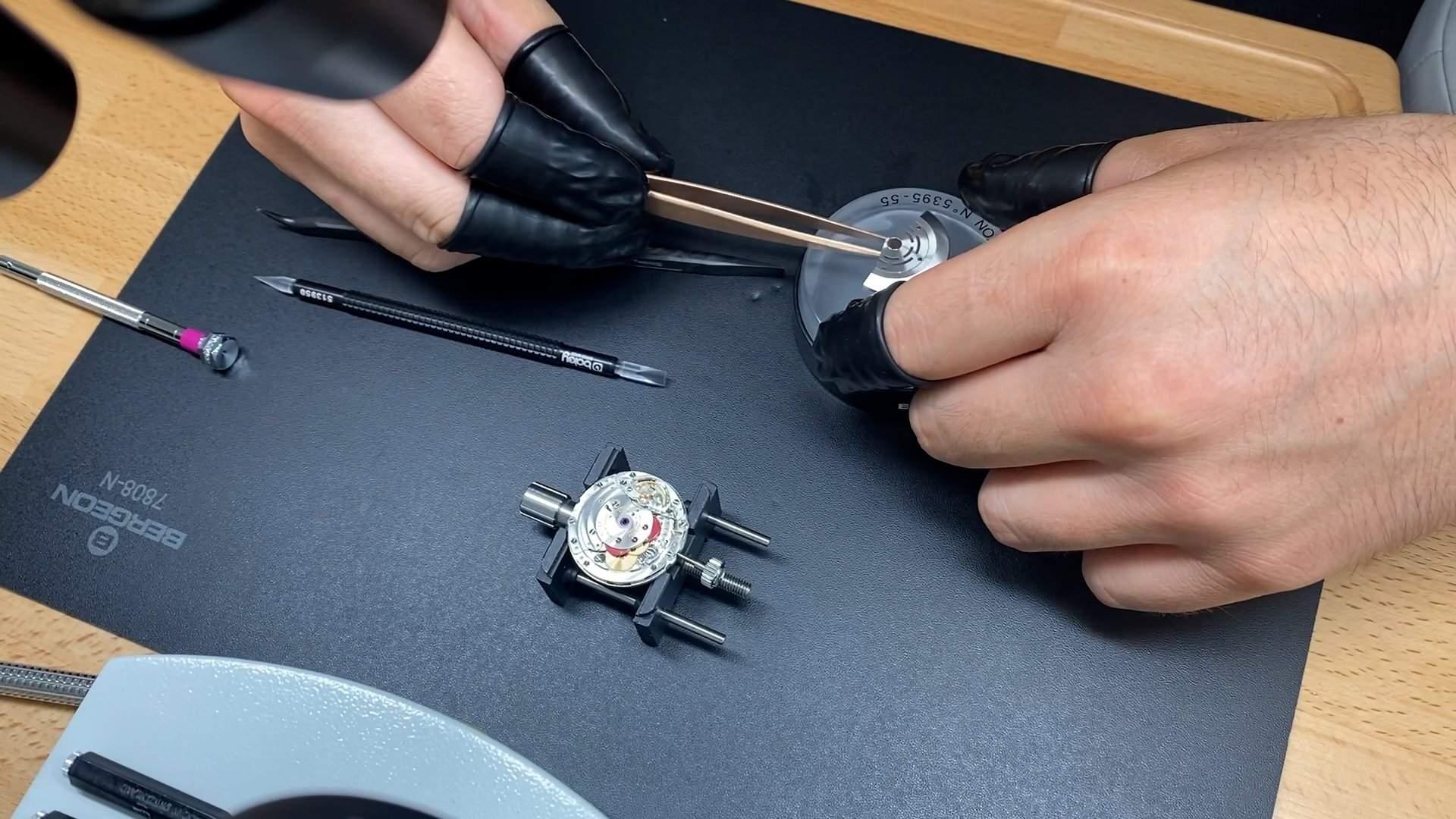 Professional watchmaker Robert Weiss dissembles a Rolex Submariner.